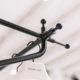 Appendiabiti in metallo negozio abbigliamento